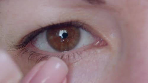 Closeup of a Woman's Eye Putting on a Contact Lens