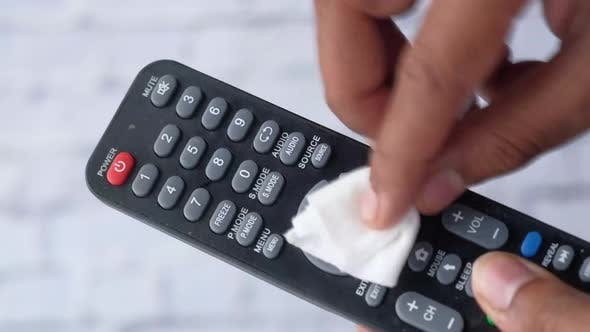 Cleaning Tv Remote Control with an Antibacterial Fabric Tissue..