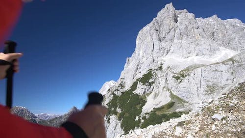 Video Couple Hiking High up in Alpine Mountains on Sunny Autumn Day