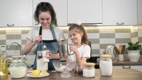 Thumbnail for Two Girls Preparing Cookies Together in Kitchen. Children Sift Flour Through Sieve
