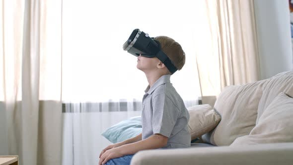 Thumbnail for Little Boy in VR Goggles