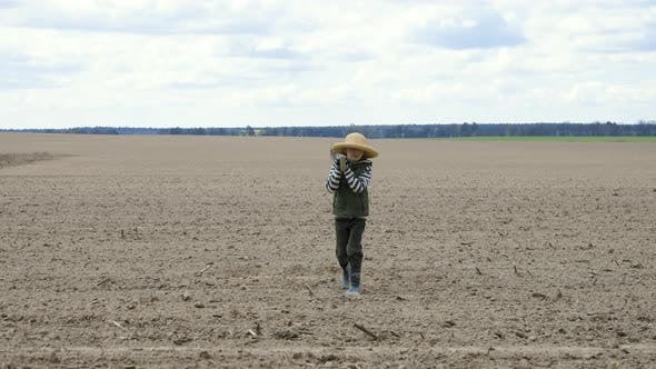 Thumbnail for Boy with a Shovel Going in the Field