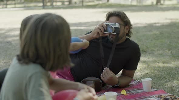 Handheld Shot of Dad with Artificial Leg Photographing His Kids