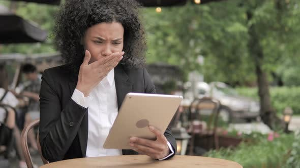 Thumbnail for Shocked African Woman Upset by Loss on Tablet, Sitting in Outdoor Cafe