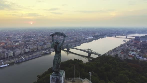 Thumbnail for Flying Around of Statue of Liberty with the Skyline of Budapest at Background.