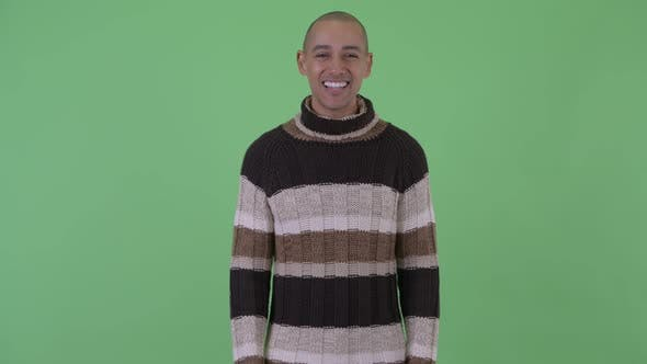 Thumbnail for Happy Bald Multi Ethnic Man Talking and Looking Excited Ready for Winter