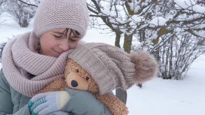 Girl with best toy in winter.
