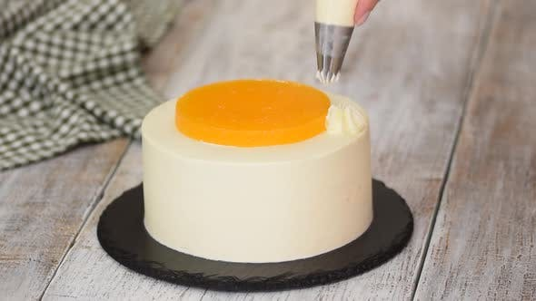 Thumbnail for The Pastry Chef Prepares and Decorated Cake with Cream