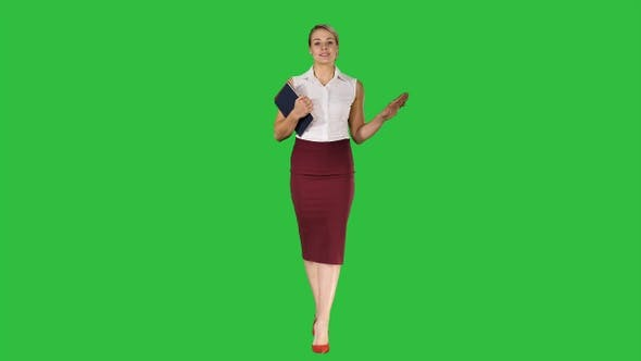 Thumbnail for Teacher talking to the camera while walking on a Green