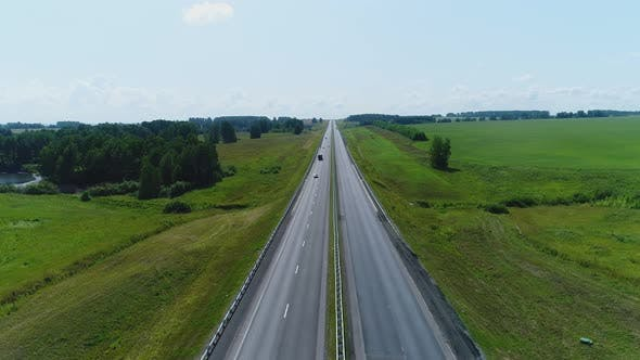 Thumbnail for Aerial View Trucks Driving Along the Highway
