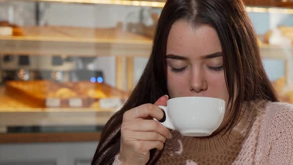 Thumbnail for Lovely Young Woman Smiling To the Camera, Drinking Coffee in the Morning
