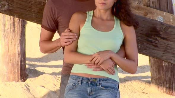 Cover Image for Portrait of serious young couple outdoors by ocean pier