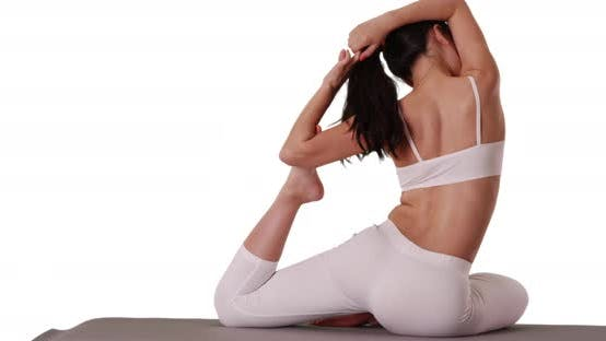 Thumbnail for Close up of yoga practitioner stretching on mat for copyspace