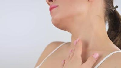 Cute Young Woman Applying Body Lotion