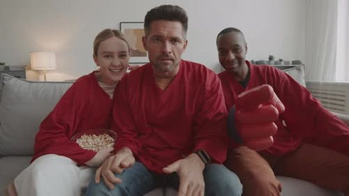 Football Fans Sitting on Couch
