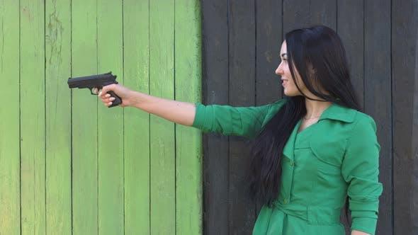 Thumbnail for Pistol in Hands of Girl.