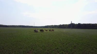 People Ride On Horseback. People riding on horse on the meadow in countryside