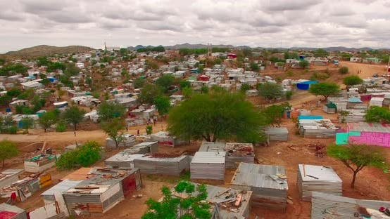 Thumbnail for A Bird's-eye View Taken Over a City with Ruined Houses in Namibia, Africa. The Poor People Live