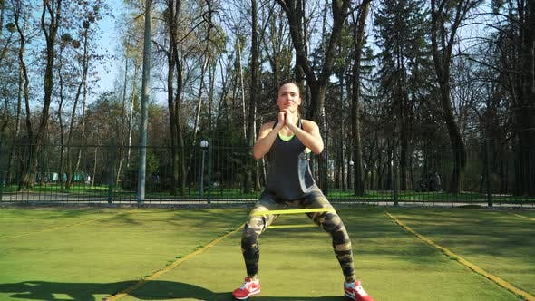 Woman doing exercises outdoors at the stadium