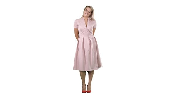 Thumbnail for Happy beautiful woman in pink dress posing on white background.