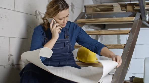 Thumbnail for Female Engineer Discussing Blueprints over Phone