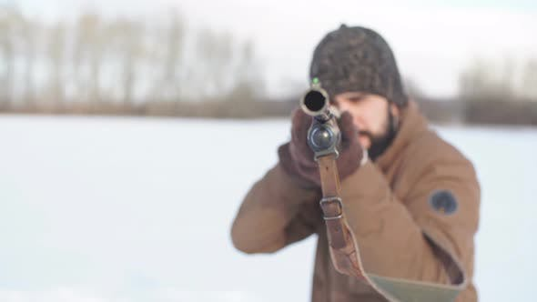 Thumbnail for Young Man Is Concentrated on Shooting