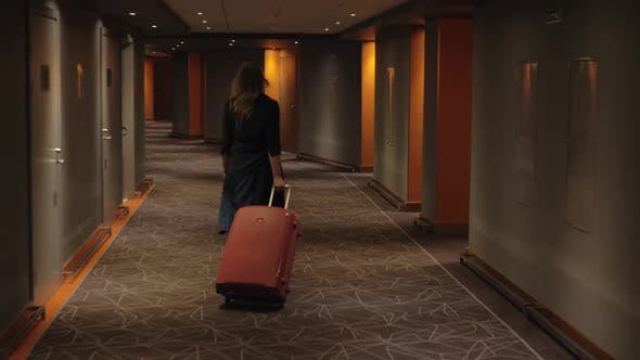 Thumbnail for - Hotel Guest with Trolley Case Walking To the Room