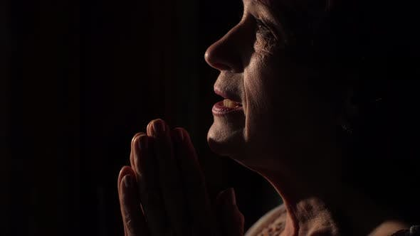 Cover Image for Woman Praying at Dark Room