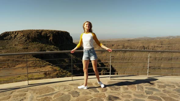 Gorgeous Female Walking and Spins - Gran Canaria Valley in Background