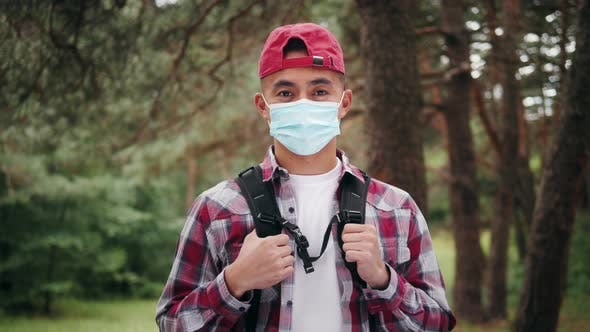 Young Asian Korean Tourist Man in Forest Wearing Medical Protective Mask Safe Travel Hiking in Park