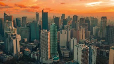 Sunset of Background Skyscrapers of Makati Distric in Manila the Capital of the Philippines