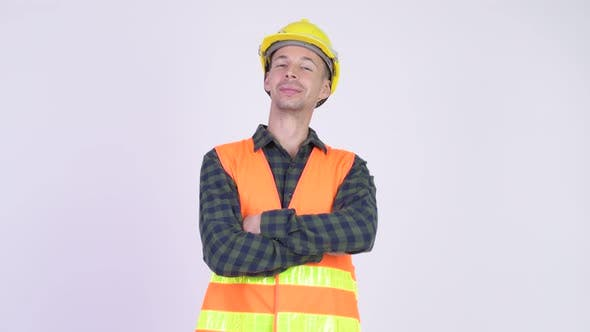 Cover Image for Studio Shot of Happy Man Construction Worker Smiling with Arms Crossed
