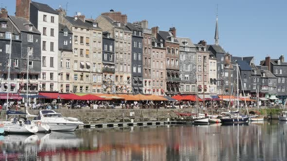 HONFLEUR, FRANCE - SEPTEMBER 2016 World  famous The Vieux Bassin port  by the day with colorful faca