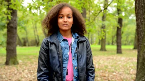 Young African Generous Girl with Fluffy Afro Hair Shows with Arms Gesture Come Here