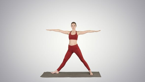 Thumbnail for Woman practicing yoga standing in Extended Side Angle
