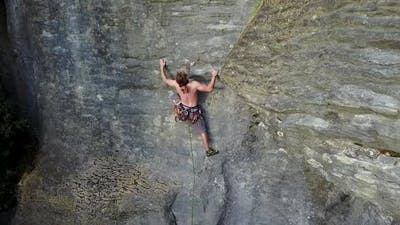 Shirtless climber