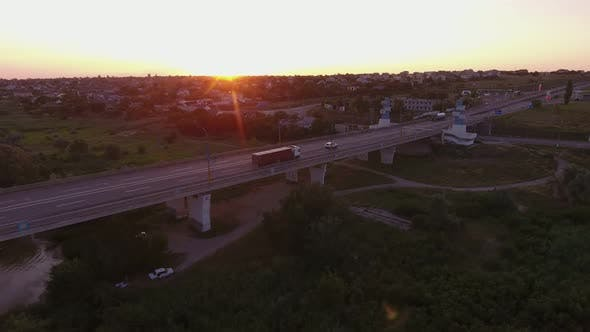 Aerial Shot of a Long Bridge Over the Dnipro at a Splendid Sunset in Summer