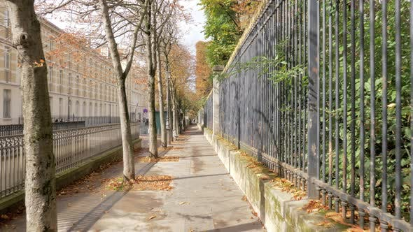 Quiet Paris street on sunny autumn day, France
