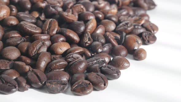 Thumbnail for Tilting over finest  Arabica coffee beans on white 4K footage