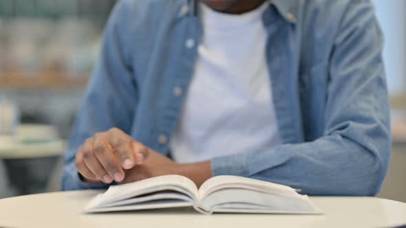 Thumbnail for African Man Reading Book Close Up