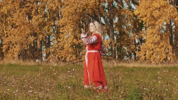 Thumbnail for Medieval Concept - Woman in Red National Long Dress Masterfully Wields Swords