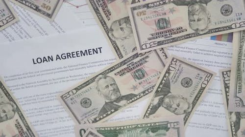 Scattered Dollars on Loan Agreement