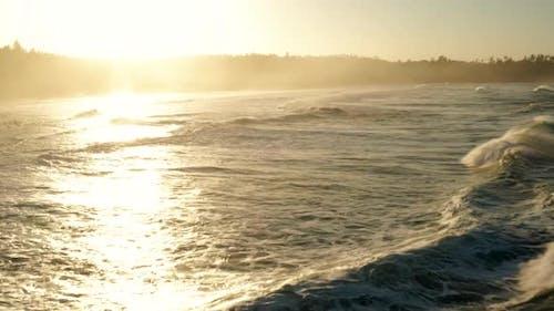 Following large waves at sunrise