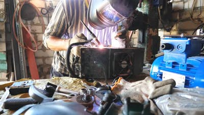 Repairer Welding Some Detail of Auto