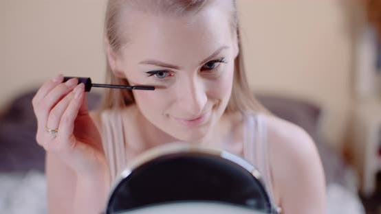 Thumbnail for Woman Doing Makeup Painting Eyelashes with Mascara