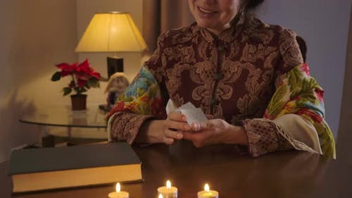Camera Moving Up, Smiling Old Caucasian Woman Shuffling Cards and Showing Queen of Diamonds