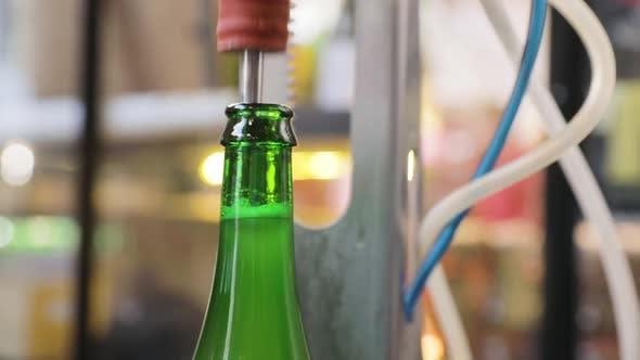 Brewery. Beer Bottle On Conveyor, Vacuum Evaporation And Corking
