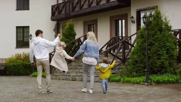 Thumbnail for Happy Couple with Kids Walking Together
