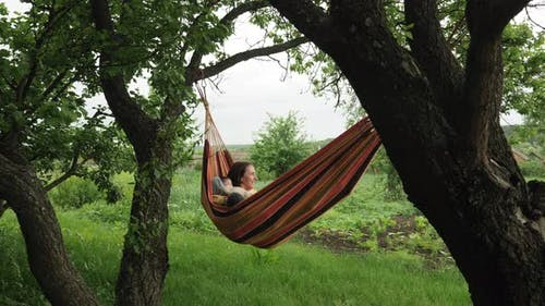Happy family relaxing in hammock