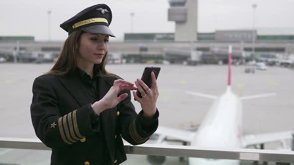 Thumbnail for Portrait of Female Pilot Officer in Uniform at Airport